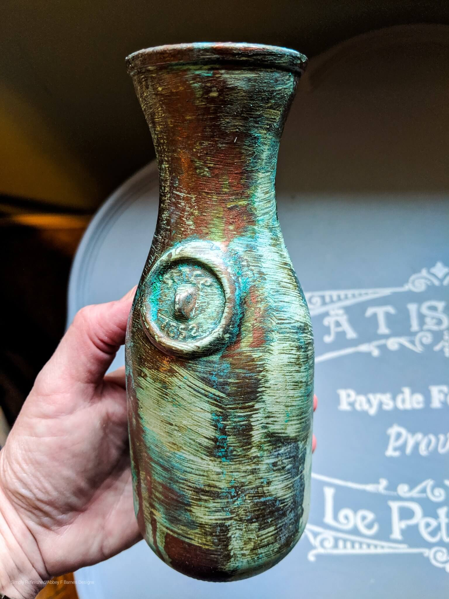 vintage glass bottle with patina finish