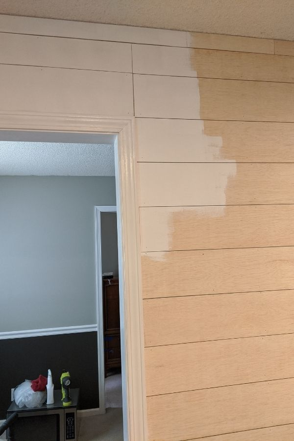 Paint the plank boards with a roller
