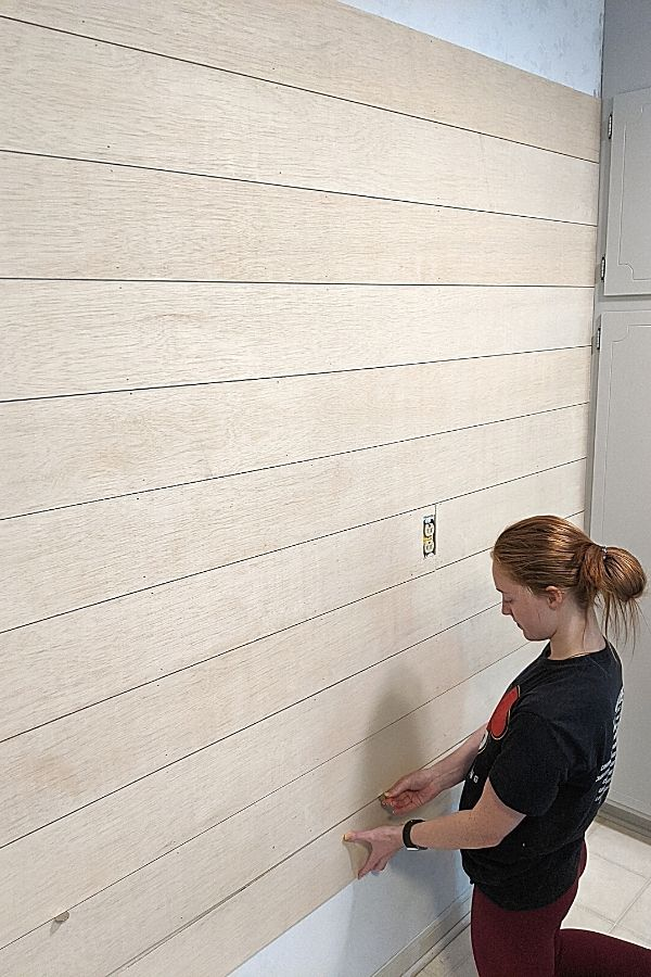 Use a Nickel to space between the planks to get that faux shiplap look