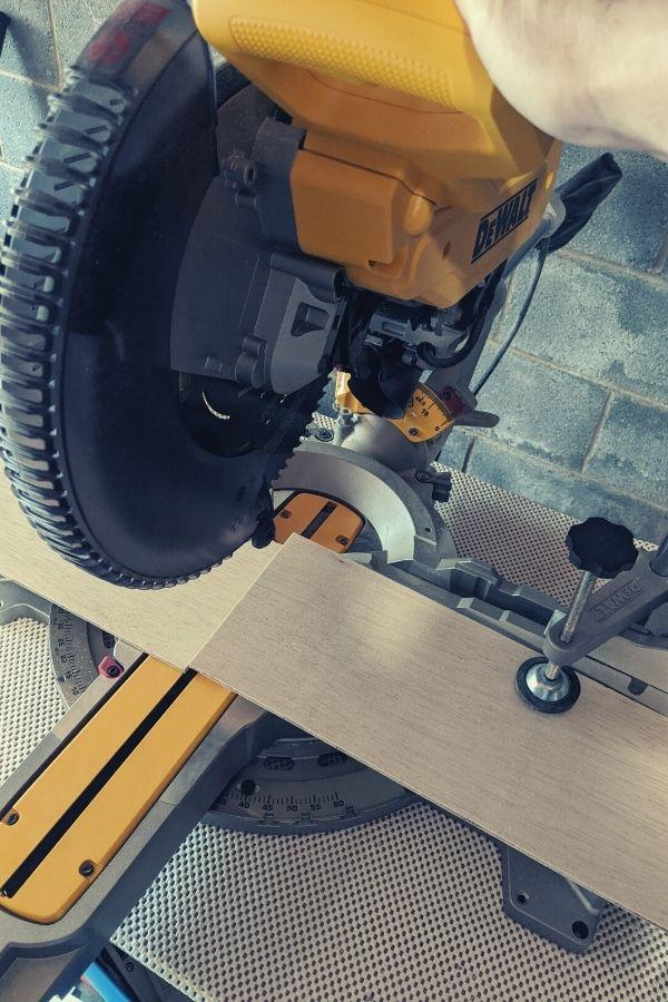 Cutting the plywood planks with a Dewalt Miter Saw