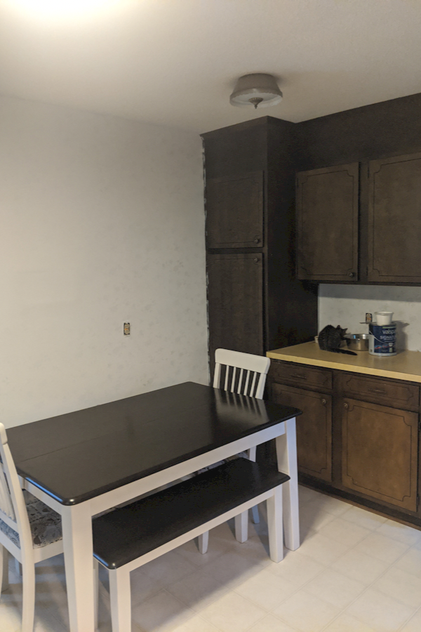 Kitchen wallpaper covered with white latex paint